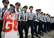 Police stand guard as anti-G8 summit protesters demonstrate in Sobetsu town, near the venue of the G8 Hokkaido Toyako Summit, on Japan's northern island of Hokkaido July 9, 2008. Photo by Lee Jae-Won (JAPAN) www.leejaewonpix.com