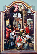 Adoration of the Shepherds'  triptych attributed to Flemish artist Cornelis Englebrechtsen (Engelberts 1468-1533).  Central panel showing the Adoration in the stable with Mary, Joseph, infant Jesus, Angels, Shepherd (with bagpipes) and Oxen. . Oil on wood.