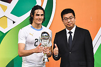 Edinson Cavani, left, of Uruguay national football team poses with his trophy after defeating Wales national football team in their final match during the 2018 Gree China Cup International Football Championship in Nanning city, south China's Guangxi Zhuang Autonomous Region, 26 March 2018.<br /> <br /> Uruguay won the final by 1-0 against Wales and claimed the title of the event.