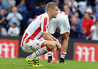 Football - 2016 / 2017 Premier League - Crystal Palace vs Stoke City<br /> <br /> Ryan Shawcross of Stoke City drops to his knees after the match at Selhurst Park<br /> <br /> <br /> Credit : Colorsport / Andrew Cowie