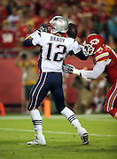 New England Patriots quarterback Tom Brady (12) gets sacked by Kansas City Chiefs outside linebacker Tamba Hali (91) who forces and recovers a fumble at the Patriots 9 yard line in the third quarter during the NFL week 4 regular season football game against the Kansas City Chiefs on Monday, September 29, 2014 in Kansas City, Mo. The Chiefs won the game 41-14. ©Paul Anthony Spinelli