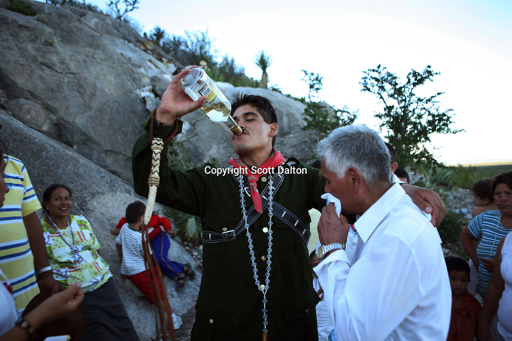 A curandero, or faith healer, believed to have healing powers when possessed, and dressed as notorious Mexican bandit Pancho Villa, takes a swig of Tequila during a healing session just outside of Espinazo, Mexico on Wednesday, October 18, 2006. Espinazo became famous because of a famed faith healer called Nino Fidencio. Fidencio died in 1938, but twice a year followers come to the small village to give thanks and pray. Many look to be healed by modern followers of Nino Fidencio who are faith healers from throughout the region who claim to be possessed by the late healer and then endowed with his legendary healing powers.  His believers, an estimated 20,000, gather in his hometown for a three-day festival twice a year in March and October. (Photo/Scott Dalton)