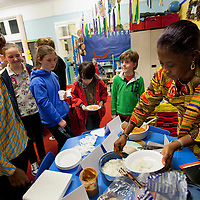 Picture Shows :  Madam Juliet Osafo Head Teacher of Juliet Johnson School serves up traditional Ghana fayre to pupils of Muthill Primary School..Muthill Primary School, Muthill by Crieff, Perthshire, Scotland stage an evening of international cooking to celebrate their joint work with a partner school Juliet Johnson School, Ghana which is visiting this week. They have strong links with the Ghanians and have helped to raise money to contribute toward funding a new school bus.   Feature for TESS..Picture Drew Farrell Tel : 07721-735041