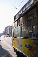 tram arrives in krakow old town on ulica pilsudskiego on sunny afternoon in september 2005