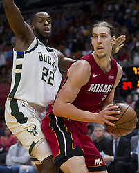 January 14, 2018 - Miami, FL, USA - Miami Heat forward Kelly Olynyk (9) looks for an open teammate as Milwaukee Bucks' Khris Middleton (22) tries to block in the second quarter on Sunday, Jan. 14, 2018 at the AmericanAirlines Arena in Miami, Fla. (Credit Image: © Matias J. Ocner/TNS via ZUMA Wire)