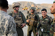 "US Marine Colonel Jeff Haynes, Commanding Officer, 201st Regional Corps Advisory Command, (left) and US Marine Sgt Major Patrick Dougherty (center) with ANA Sgt Major Armanzi inspecting ANA progress in the Tagab Valley.  In the back ground is heavy equiptment used to grade the road.   ....One of the main tactics is a new road through Tagab Valley that will allow traffic to bypass Kabul providing a more direct link between Pakistan and destinations north including Uzbekistan and Tajikistan.....To win the Tagab Valley, Colonel Haynes said, ""The creeping barrage of goodness, really centers on the road going up the valley, because then you can begin development projects and increase prosperity.  The cab fare for villagers went from $8 down to $1 just because the ANA graded the road.""  As the ANA move north through the valley they are building combat outposts to sustain the gains.  Haynes confirmed this is an ANA campaign - the first of its kind - his soldiers are mentoring the ANA, there are no coalition troops.  .."