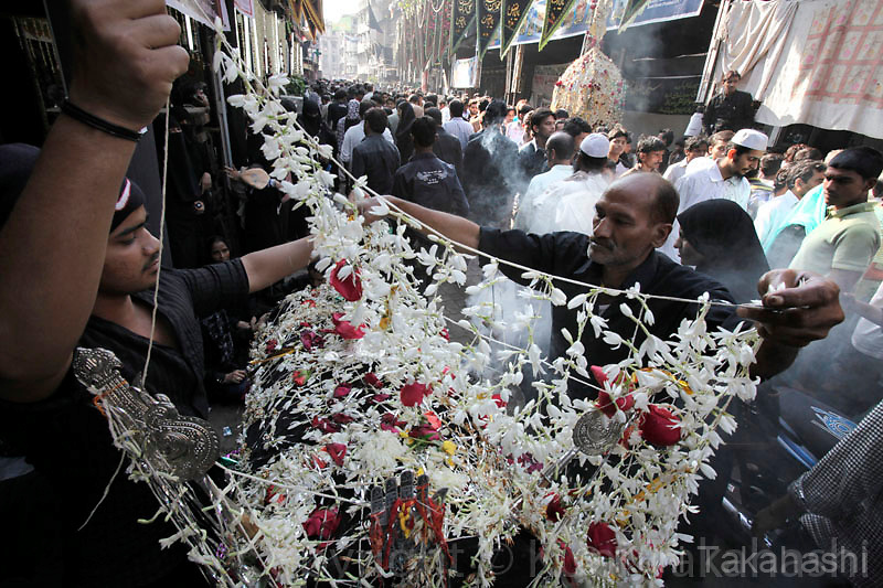 Men decorate a model of shrine of Imam Husein with flowers during Ashura in Mumbai, India, Monday, Dec. 28, 2009. Ashura, which falls on the 10th day of Muharram under the Islamic lunar calendar, is one of the most important holy days for Shiite Muslims. It marks the death of Islam's Prophet Muhammad's grandson Imam Hussein..Photo by Kuni Takahashi.