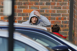 © Licensed to London News Pictures. 23/10/2016. London, UK. A man local residents believe to be Jason Matthew's son arrives at a house under siege by armed police in Lancaster Road in Northolt on Sunday, 23 October 2016. Police surround the address after a report of concerns for the occupant and hazardous items inside the property. Police believe a man is still inside the house. Photo credit: Tolga Akmen/LNP