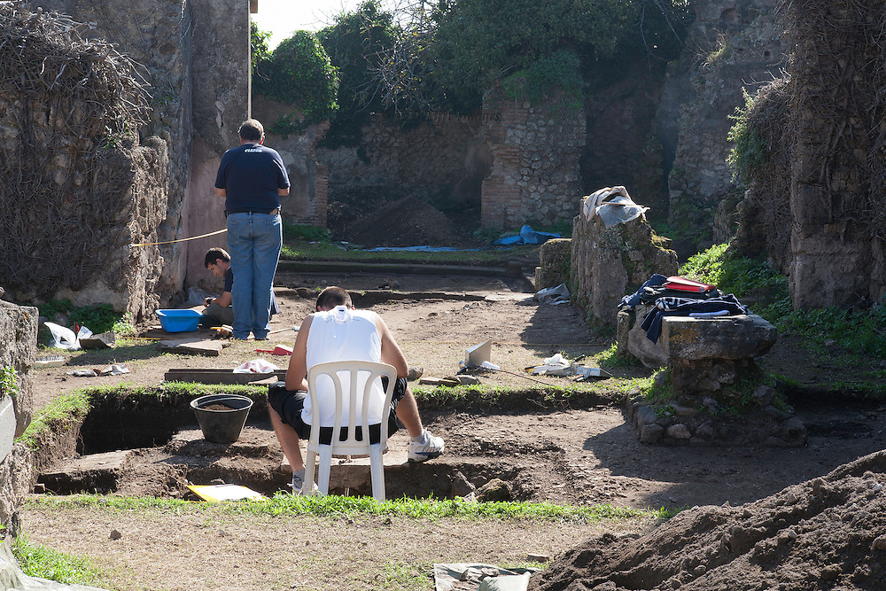 Pompeii  archaeologists at work in one of the houses under excavation.