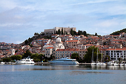Sibenik, Croatia as seen from harbour approach. St. Michael's Fortress dominates the skyline. Thought to date to the late 8th or early 9th century, the site itself has been occupied since the Iron Age. Fresj from an EU-funded restoration, it opened to the public again in 2014.