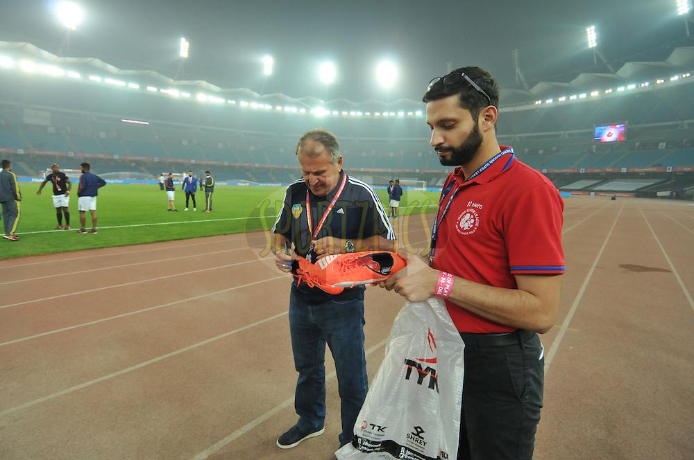 FC Goa coach Zico signature on football boot before match 56 of the Indian Super League (ISL) season 2  between Delhi Dynamos FC and FC Goa held at the Jawaharlal Nehru Stadium, Delhi, India on the 6th December 2015.<br /> <br /> Photo by Arjun Singh  / ISL/ SPORTZPICS