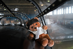 © Licensed to London News Pictures. <br /> 28/08/2014. <br /> <br /> Durham Tees Valley Airport, United Kingdom<br /> <br /> A good luck mascot sits on the cockpit of one of only two remaining flying Avro Lancaster bombers as it visits Durham Tees Valley airport today. <br /> <br /> The aircraft, 'Mynarski' is named after Pilot Officer Andrew Mynarski who flew with the Canadian Royal Air Force from the airport which was then called RAF Middleton St George.<br /> <br /> Pilot Officer Mynarski was posthumously awarded a VC after giving his life while trying to save a colleague when their Lancaster was shot down in June 1944.<br /> <br /> The famous World War Two aircraft is owned by the Canadian Warplane Heritage Museum and is beginning a 2-week tour of the UK.<br /> <br /> Photo credit : Ian Forsyth/LNP