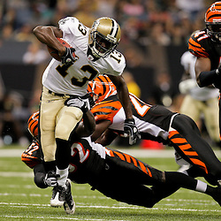 2009 August 14: New Orleans Saints wide receiver Rod Harper (13) evades the tackle of several Bengals defenders during 17-7 win by the New Orleans Saints over the Cincinnati Bengals in their preseason opener at the Louisiana Superdome in New Orleans, Louisiana.
