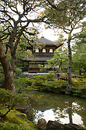 The Silver Pavilion reflected in a pond surrounded by pine trees in the Ginkaku-ji Pure Land Garden Kyoto,  Japan
