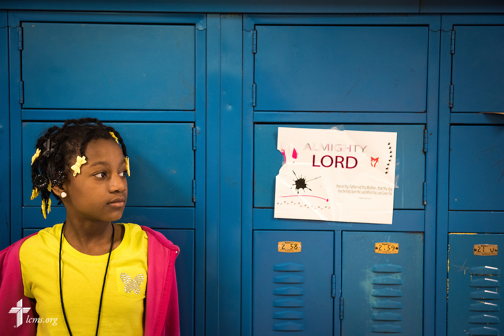 Naomi Sampton waits for lunch outside a classroom at Lutheran Special School & Education Services, located in Milwaukee Lutheran High School, on Tuesday, May 19, 2015, in Milwaukee, Wis. LCMS Communications/Erik M. Lunsford