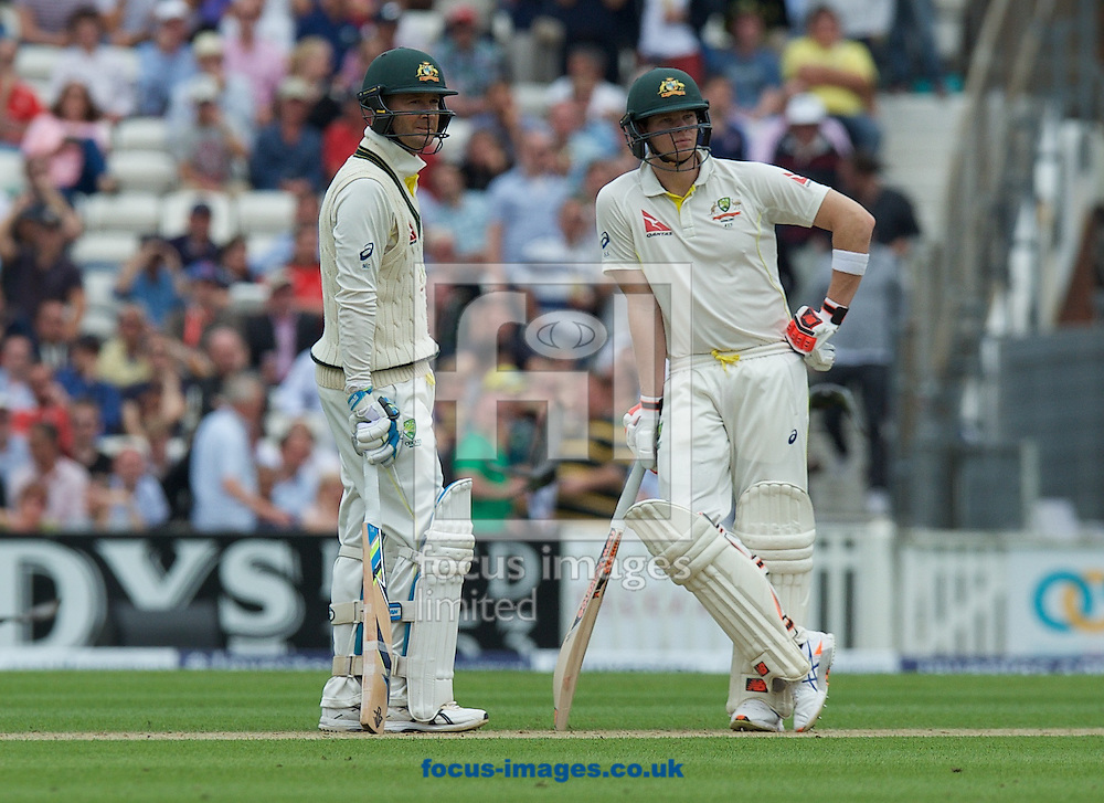 Batsman and Captain Michael Clarke of Australia (left) waits at the wicket for the review with Steven Smith but is given out during the 5th Investec Ashes Test Match match at the Kia Oval, London<br /> Picture by Alan Stanford/Focus Images Ltd +44 7915 056117<br /> 20/08/2015