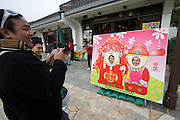 Lantau island. Ngong Ping Plateau. Tourists taking souvenir photos as Chinese Emperor and wife.