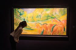 Sotheby's, London, January 28th 2016. A woman examines Grosse Landschaft 1 (Large Landscape 1)  by Franz Marc, which is valued at between £4 - 6 million, to be auctioned by Sotheby's in London as part of their sale of Impressionist, Modern, Surrealist and Contemporary art. ///FOR LICENCING CONTACT: paul@pauldaveycreative.co.uk TEL:+44 (0) 7966 016 296 or +44 (0) 20 8969 6875. ©2015 Paul R Davey. All rights reserved.