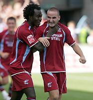 Photo: Steve Bond.<br />Scunthorpe United v Sheffield United. Coca Cola Championship. 01/09/2007. Kelly Youga (L) congratulates Martin Paterson (R)