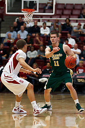 Nov 15, 2011; Stanford CA, USA;  Colorado State Rams guard Jesse Carr (11) is defended by Stanford Cardinal guard Aaron Bright (2) during the first half of a preseason NIT game at Maples Pavilion. Stanford defeated Colorado State 64-52. Mandatory Credit: Jason O. Watson-US PRESSWIRE