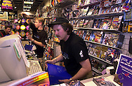 Eli Kowalski, manager of Electronics Boutique, fills an advance order of PlayStation 2, for a customer, after the game system went on sale shortly after midnight, Thursday, Oct. 26, 2000, at Franklin Mills Mall, in Philadelphia. (Photo by William Thomas Cain/Photojournalist.cc)