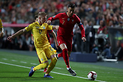 March 22, 2019 - Lisbon, Portugal - Portugal's forward Cristiano Ronaldo vies with Ukraine's midfielder Oleksandr Zinchenko during the UEFA EURO 2020 group B qualifying football match Portugal vs Ukraine, at the Luz Stadium in Lisbon, Portugal, on March 22, 2019. (Credit Image: © Pedro Fiuza/ZUMA Wire)