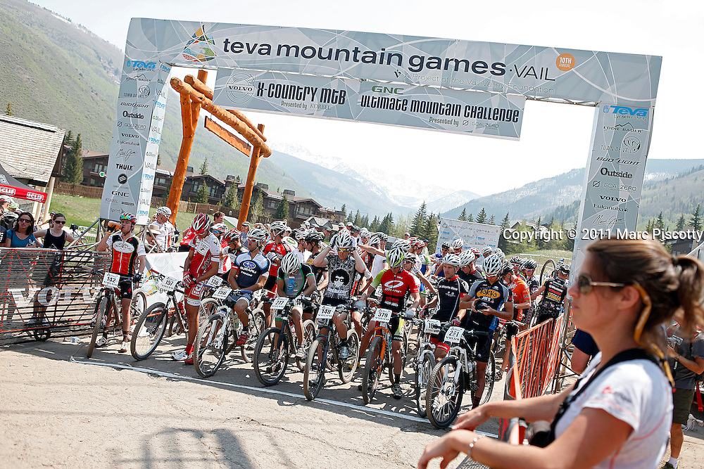 SHOT 6/4/11 11:40:56 AM - Pro mountain bike racers prepare for the start of the Men's Pro race at the 10th Annual Teva Mountain Games in Vail, Co. Professional and amateur outdoor adventure athletes from the Vail Valley and around the world will converge upon the mountains and rivers of Vail to compete in eight sports and 23 disciplines including: x-country, freeride, slopestyle and road cycling, freestyle, 8-Ball, sprint and extreme kayaking, raft cross, World Cup Bouldering, stand up paddle sprint and surf cross, as well as trail, mud and road running, dog comps and the GNC Ultimate Mountain Challenge.. (Photo by Marc Piscotty / © 2010)