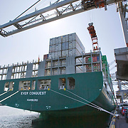 Nederland Zuid-Holland Rotterdam  27-08-2009 20090827 Foto: David Rozing .Serie over logistieke sector.ECT Delta terminal in de haven van Rotterdam. .Containerschip Ever Conquest ligt afgemeerd aan de kade om te worden gelost. .ECT,European Container Terminals, at the Port of Rotterdam. Europe's biggest and most advanced container terminal operator, handling close to three- quarters of all containers passing through the Port of Rotterdam. ECT is a member of the Hutchison Port Holdings group (HPH), the world's biggest container stevedore with terminals on every Continent. At the ECT Delta Terminal unmanned, automated guided vehicles - so-called AGVs - transport the containers between ship and stack. In the stack, unmanned automated stacking cranes (ASCs) ensure that the containers are always stacked in the correct place. Thanks to the water depth ans its strategic location, many shipping lines have chosen the ECT delta Terminal as both their first and last European port of call. Terminal operations are highly automated. Consequently, the ECT Delta Terminal is exceptionally well suited to discharging and loading large volumes. ECT Delta Terminal offers an unequalled water depth. Rail Facilities.The ECT Delta Terminal has it own state-of-the-art rail facilities..    ..Holland, The Netherlands, dutch, Pays Bas, Europe .Foto: David Rozing