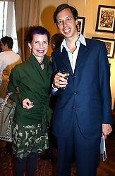 MISS NATHALIE HAMBRO and PHILIPPE CAMU at a an exhibition of prints by art dealer Martin Summers held at 73 Glebe Place, London on 29th June 2004.