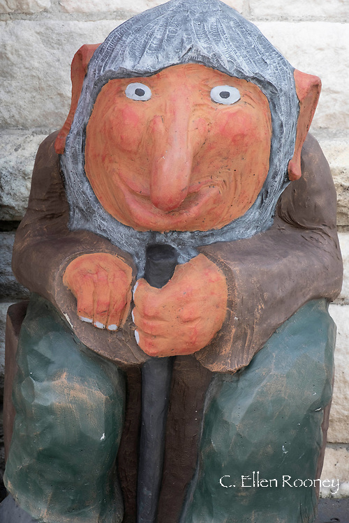 A troll, carved wooden figure outside a shop in Alesund, Noway