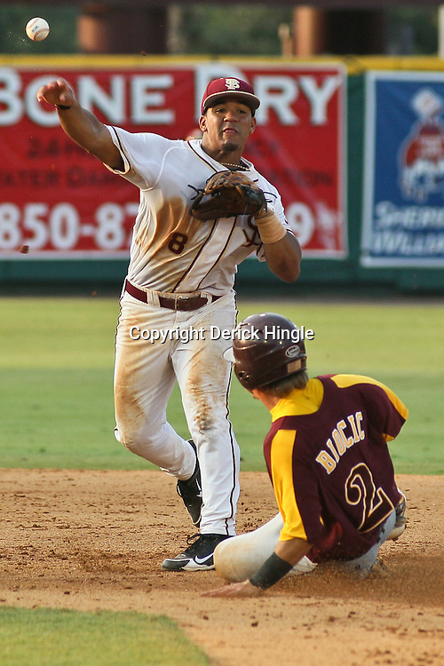 June 03, 2011; Tallahassee, FL, USA; Bethune-Cookman Wildcats designated hitter Paul Biocic (2) is forced out by Florida State Seminoles second baseman Devon Travis (8) during the fifth inning of the Tallahassee regional of the 2011 NCAA baseball tournament at Dick Howser Stadium. Mandatory Credit: Derick E. Hingle