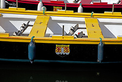 Brightly painted boats add to the color of the harbor at Martigues on the Provencal coast of southern France.