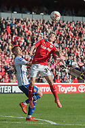 Lloyd Isgrove of Barnsley heads clear of Kieron Morris of Walsall during the Sky Bet League 1 Playoff Semi Final First Leg at Oakwell, Barnsley<br /> Picture by Matt Wilkinson/Focus Images Ltd 07814 960751<br /> 14/05/2016
