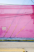 Utility pole guy wires against a pink wall at NW 24th Street in Miami's Wynwood disrict in 2008