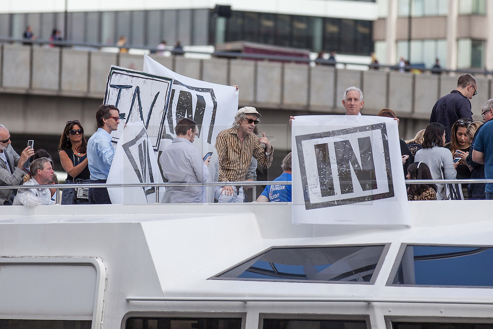 © Licensed to London News Pictures. 15/06/2016. London, UK. Sir Bob Geldoff (centre) speaks on an 'IN' campaign boat, with Rachel Johnson, Boris Johnson's sister, on board, as they meet a flotilla of fishing trawlers led by Nigel Farage as they sail up the River Thames to Westminster. The flotilla is organised by the 'Fishing for Leave' campaign, founded by Scottish fisherman, which argues that the UK's fishing industry would be better off outside the EU, but with the same status as Iceland or Norway when fishing quotas are negotiated. Photo credit: Rob Pinney/LNP