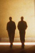 Silhouette of two men walking