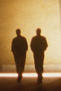 Silhouette of two men walking