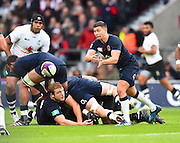 England scrum half Ben Youngs off loads the ball during the Autumn International Series match between England and Fiji at Twickenham, Richmond, United Kingdom on 19 November 2016. Photo by Ian  Muir.
