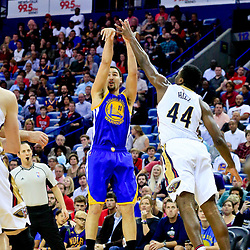 Oct 28, 2016; New Orleans, LA, USA;  Golden State Warriors guard Klay Thompson (11) shoots over New Orleans Pelicans forward Solomon Hill (44) during the first quarter of a game at the Smoothie King Center. Mandatory Credit: Derick E. Hingle-USA TODAY Sports