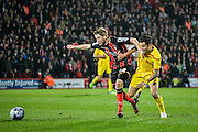 Eunan O'Kane beats Phillipe Coutinho to the ball during the Capital One Cup match between Bournemouth and Liverpool at the Goldsands Stadium, Bournemouth, England on 17 December 2014.