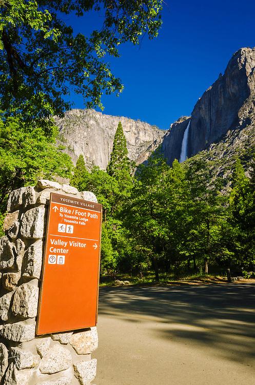 Yosemite Village sign under Yosemite Falls, Yosemite National Park, California USA