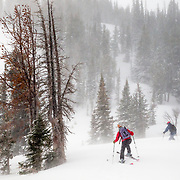 Heather Goodrich and Tyler Hatcher sidestep their way into the backcountry near Jackson Hole Mountain Resort in Teton Village, Wyoming.