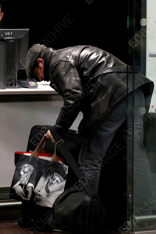 13.FEBRUARY.2012. LONDON<br /> <br /> JEAN DUJARDIN CHECKS INTO THE EUROSTAR IN LONDON<br /> <br /> BYLINE: EDBIMAGEARCHIVE.COM<br /> <br /> *THIS IMAGE IS STRICTLY FOR UK NEWSPAPERS AND MAGAZINES ONLY*<br /> *FOR WORLD WIDE SALES AND WEB USE PLEASE CONTACT EDBIMAGEARCHIVE - 0208 954 5968*