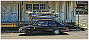 Beat-up old car loaded with windsurfers near the Presideo, Golden Gate National Recreation Area, San Francisco, California.