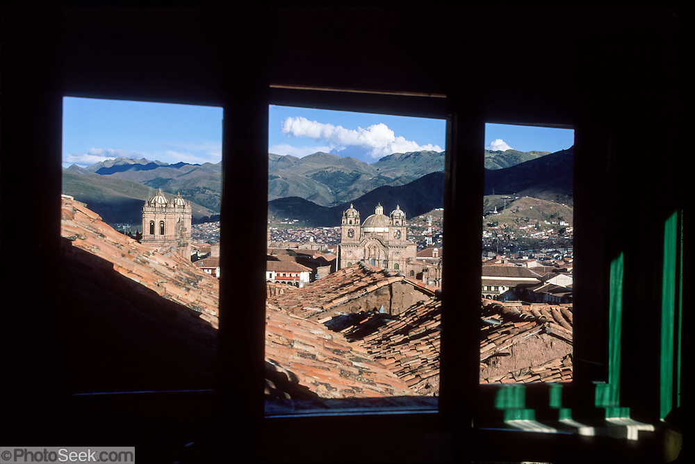 From Hostal Corihuasi, look towards the Plaza de Armas (central square) of Cuzco (Cusco or Qosqo), in Peru, South America. Cuzco was the site of the historic capital of the Inca Empire from the 1200s to 1532 and was honored on the World Heritage List in 1983 by UNESCO. Quechua oral history says that the first Inca, Manco Capac, the son of the sun god (inti), founded the city of Cuzco in the 1100s AD. After 1430 AD, the Incas burst out of Cuzco and quickly imposed their culture from southern Colombia to central Chile. The Incas used their absolute rule and organizational genius to build vast terraces for growing food on the steep Andes Mountains in a moderate climate, away from the dry desert coast and above the mosquito-filled Amazon Basin. The Incas developed textiles, pottery, metals, architecture, amazingly fitted rock walls, empire-wide roads, bridges, and irrigation, but never discovered the wheel, arch, or writing. Despite their amazing accomplishments, the Inca Empire lasted barely a century.