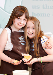 25/05/2013 .Pictured Katie Sheehan (11) and Ali Dodd (8) from Tyrrelstown cutting some cookies at the grand opening of the Butler's Pantry's shop in Castleknock making it their TENTH shop in Dublin and Wicklow. The Butler's Pantry is promising the very best of Irish artisan ingredients in each dish, which will be cooked using authentic Irish cooking methods and the best of classic Irish kitchen traditions in their Bray kitchens. Picture Andres Poveda..For further information please contact Ann-Marie Sheehan, Aspire PR, T : 0872985569 E : annmarie@aspire-pr.com .