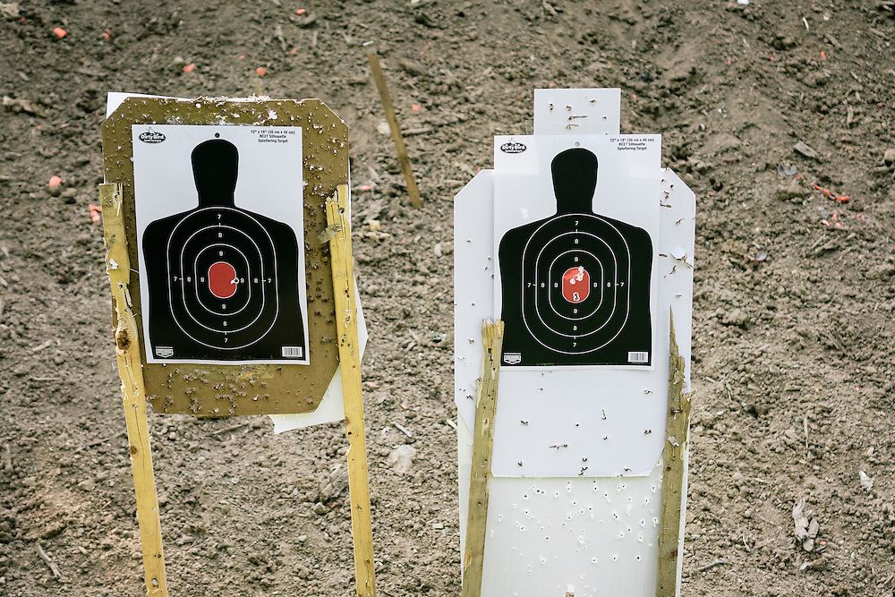 Targets show the accuracy of the Tracking Point TP750 rifle. A single shot hitting the adjacent target to the left shows what hacking the rifle can do.
