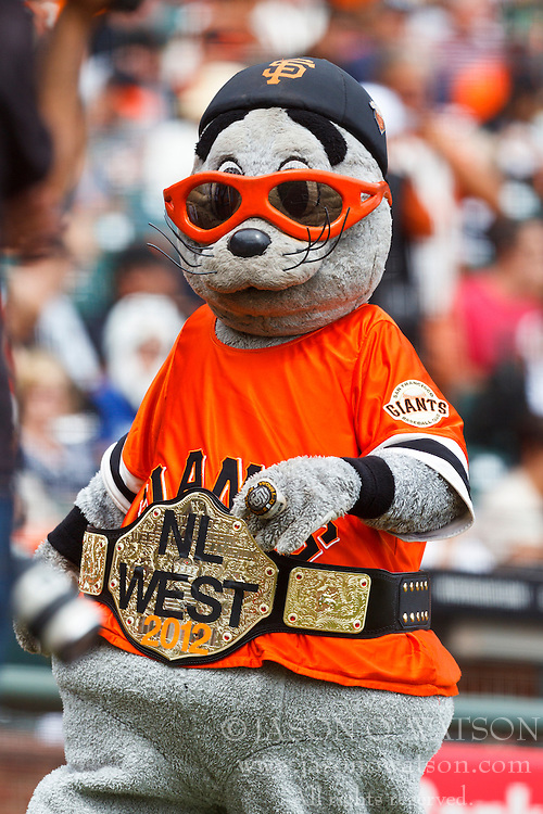 SAN FRANCISCO, CA - SEPTEMBER 23: The San Francisco Giants mascot Lou Seal wears a belt celebrating the National League West Division championship during the first inning against the San Diego Padres at AT&T Park on September 23, 2012 in San Francisco, California. (Photo by Jason O. Watson/Getty Images) *** Local Caption ***