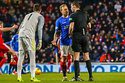 Scott Arfield talks to the referee following his decision  during the William Hill Scottish Cup quarter final replay match between Rangers and Aberdeen at Ibrox, Glasgow, Scotland on 12 March 2019.