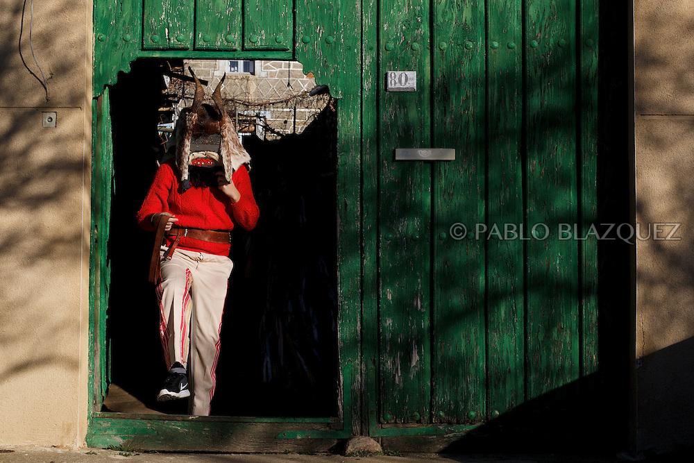 A man dressed as El Diablo leaves a house during La Filandorra festival on December 26, 2016 in the small village Ferreras de Arriba, Zamora province, Spain.  La Filandorra festival is a pagan winter masquerade that takes place during Saint Esteban festivities. The parade is represented by four characters, La Filandorra, El Diablo (Devil), La Madama (madame) y El Galán (Gallant). (© Pablo Blazquez)